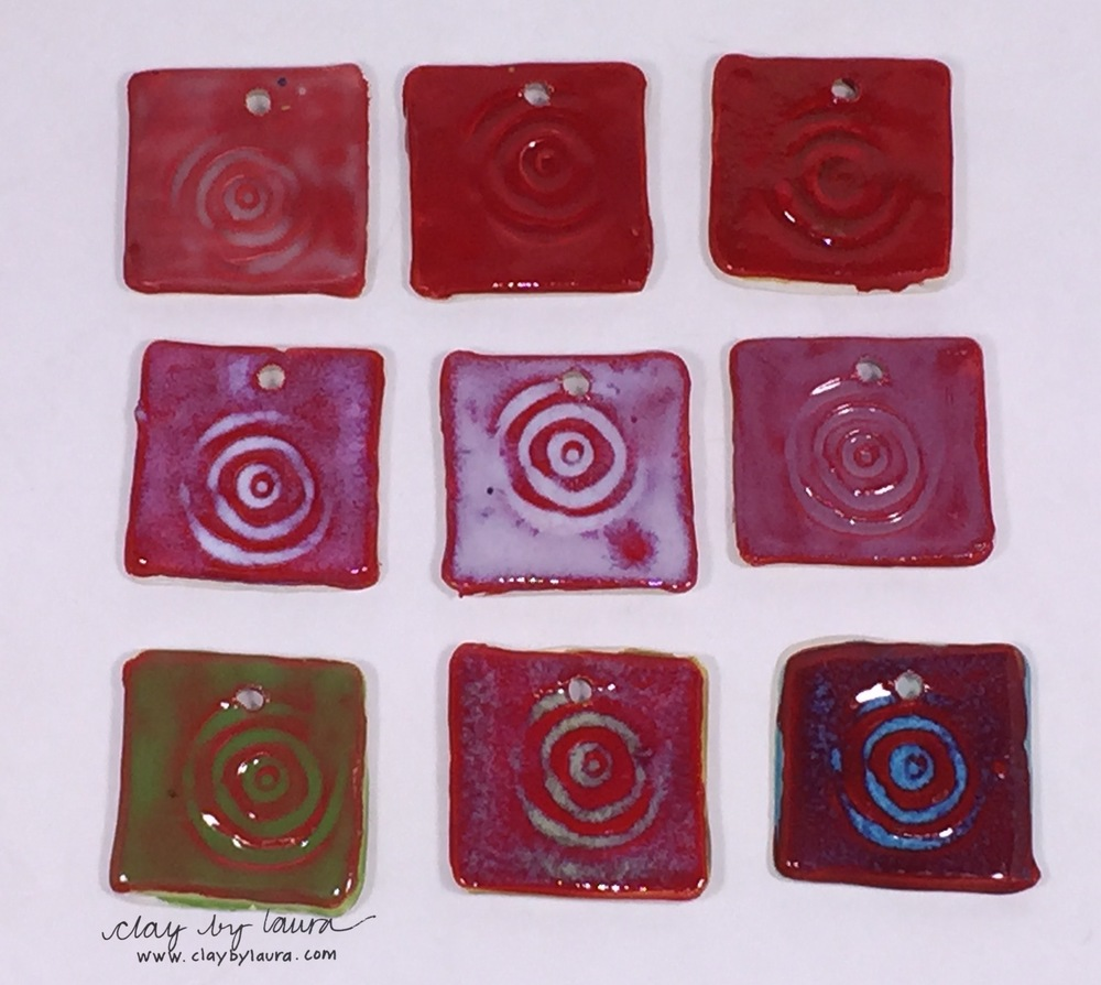 Here I used red base color on test tiles with a variety of glaze colors.