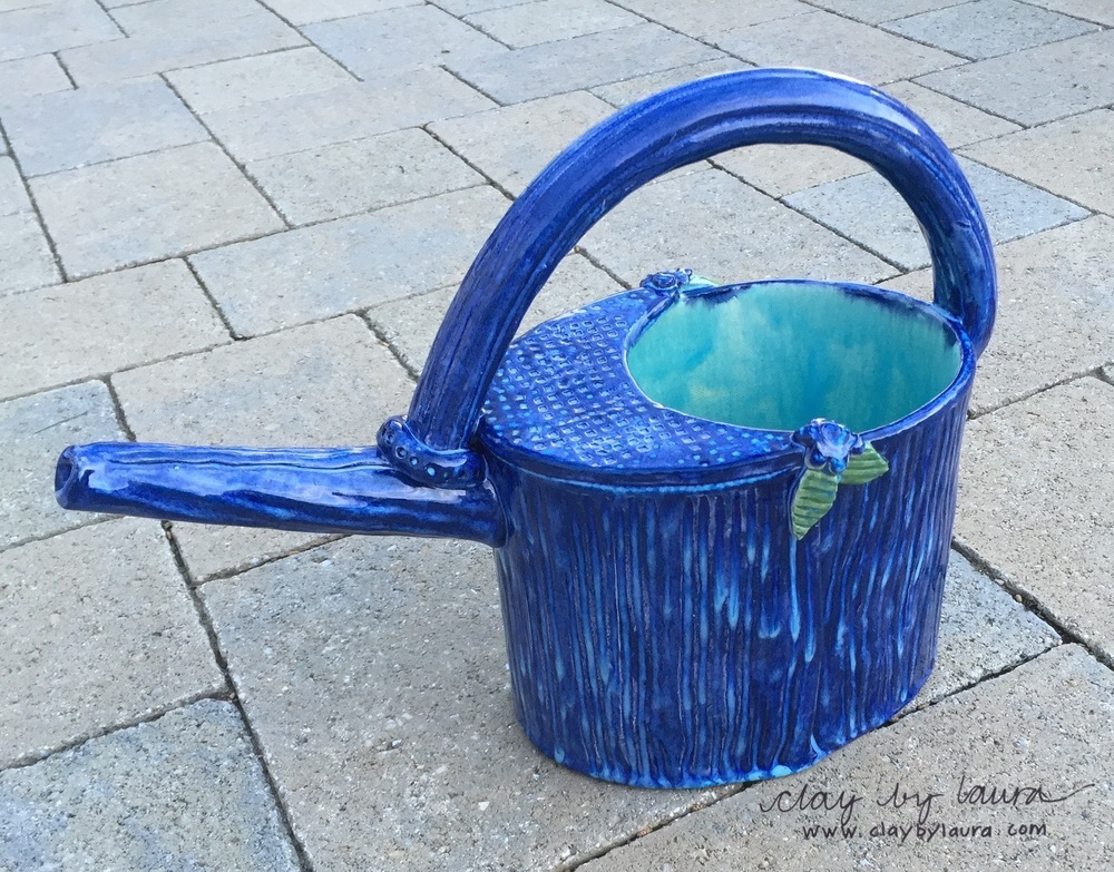 Cass Molander of Cedar Rapids, Iowa is the WINNER of the watering can giveaway!