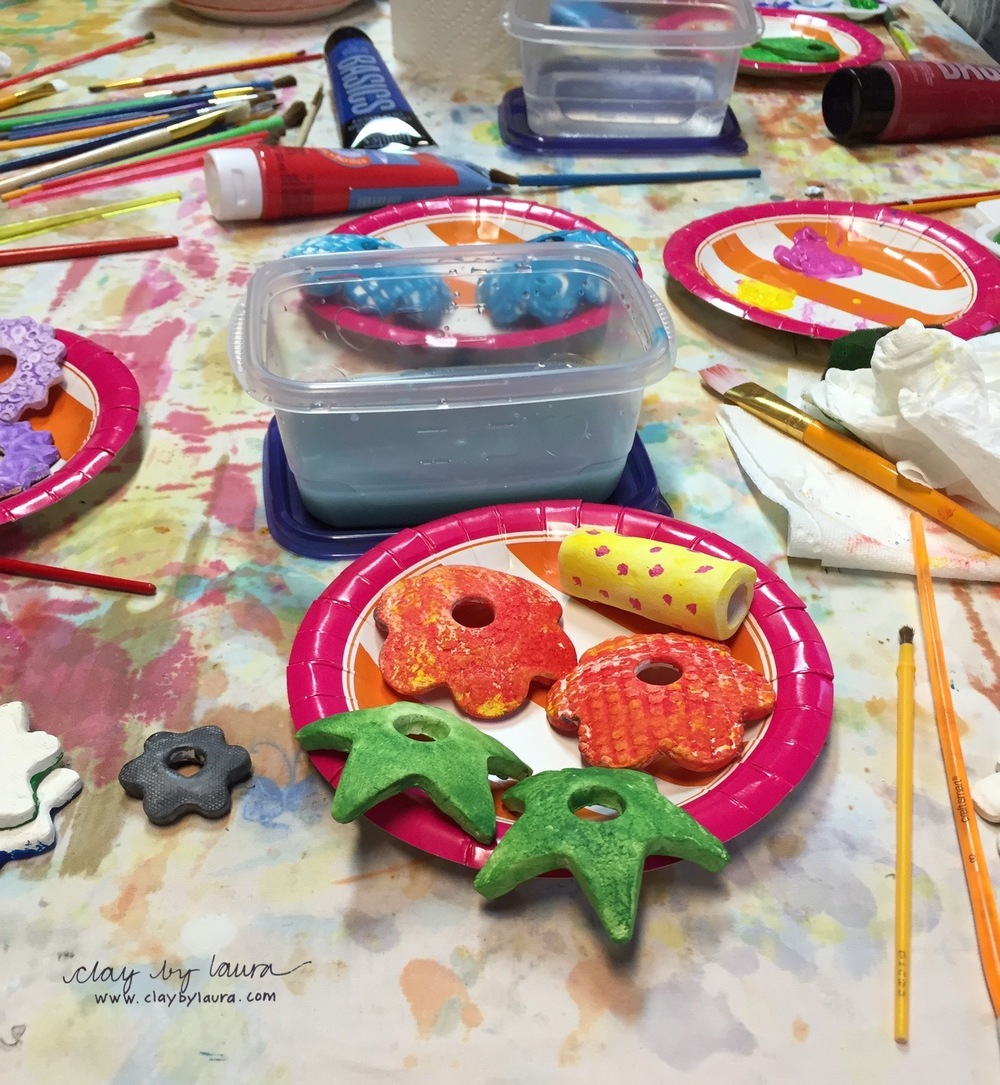 Students used acrylic paints to decorate the clay and then sealed each one with a glossy finish.