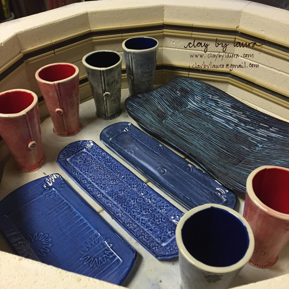I fired a glaze kiln this week containing some tray and bowl sets and several new items like tumblers.
