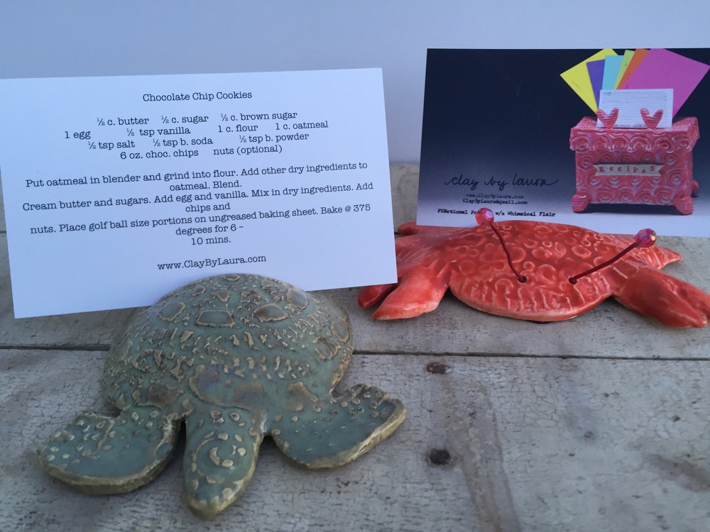 I like to include a recipe with many of my ClayByLaura pieces. I've recently updated and upgraded my recipe cards shown here with these fun sea turtle and crab holders. When you're not cooking, they can hold a favorite photo!
