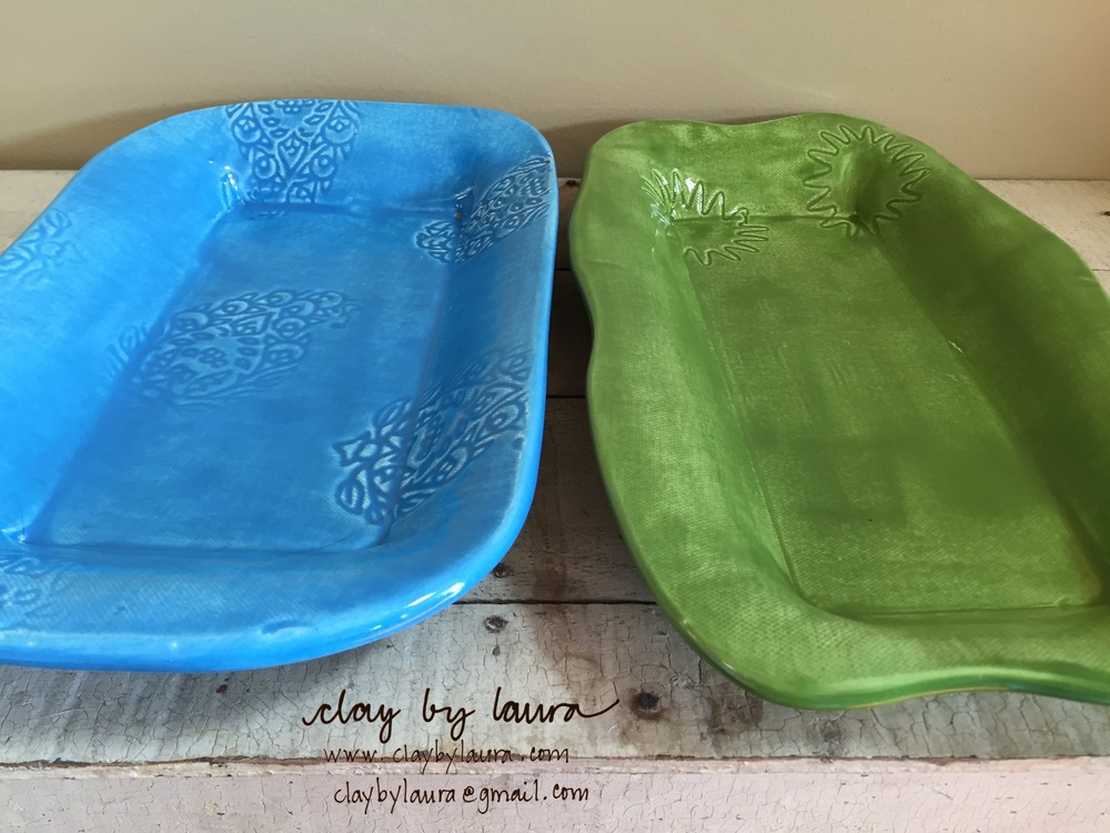 I made these two trays in 2003. It was the beginning of my exploration of color and texture in my clay art. I use them often to serve crackers and cheese, a loaf of banana bread or an array of fruit.