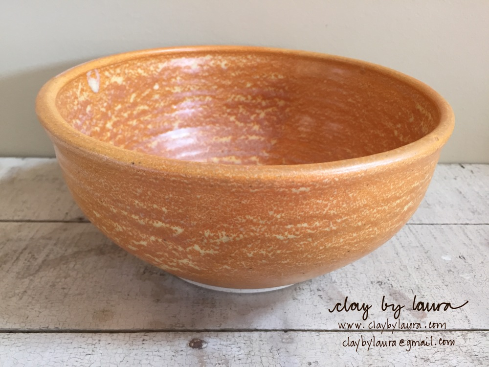 I made this bowl in 2002 when I was using the potters wheel and a different glaze technique at a community studio. It was one of the few 'bright' colors available. It's the perfect serving size for any side dish I've made for a meal.