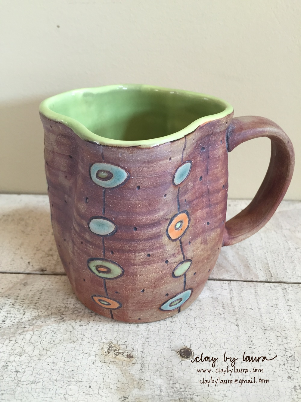 I bought this fun mug at a craft show from Sarah McCarthy. I just love its unique shape in addition to it's wonderful glaze technique. When I'm not using one of my own mugs, I reach for this one.