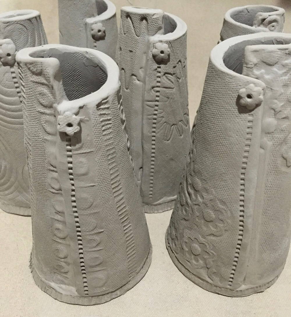 These new vase shapes are in process. I like the uneven rim. What colors should I use for the glaze? Click on the photo to let me know.
