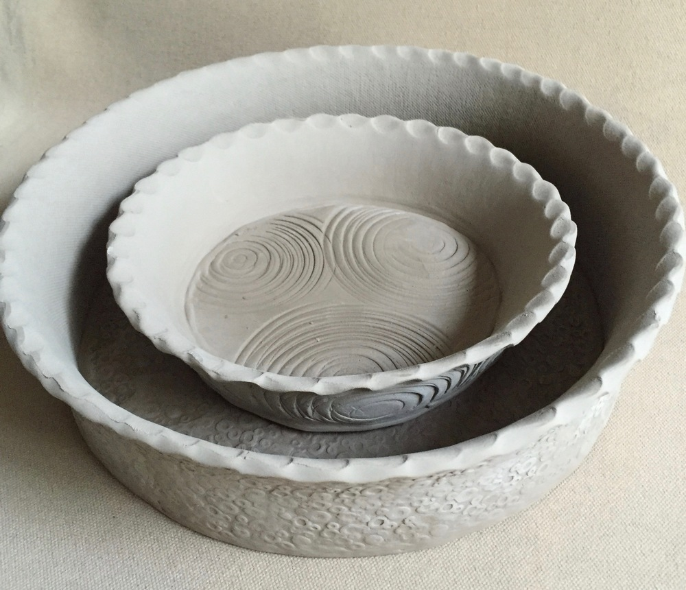 I've had a custom request for pie dishes. I based the design on some of the baking dishes I've made recently. Here, I started with the large deep dish size  (9 inches diameter x 3 inches tall) and then decided to make a smaller personal pie size (5 inches diameter x 2 inches tall) version as well. I can see a beautiful quiche or blueberry pie in the large size. A baked brie might work well in the smaller size!