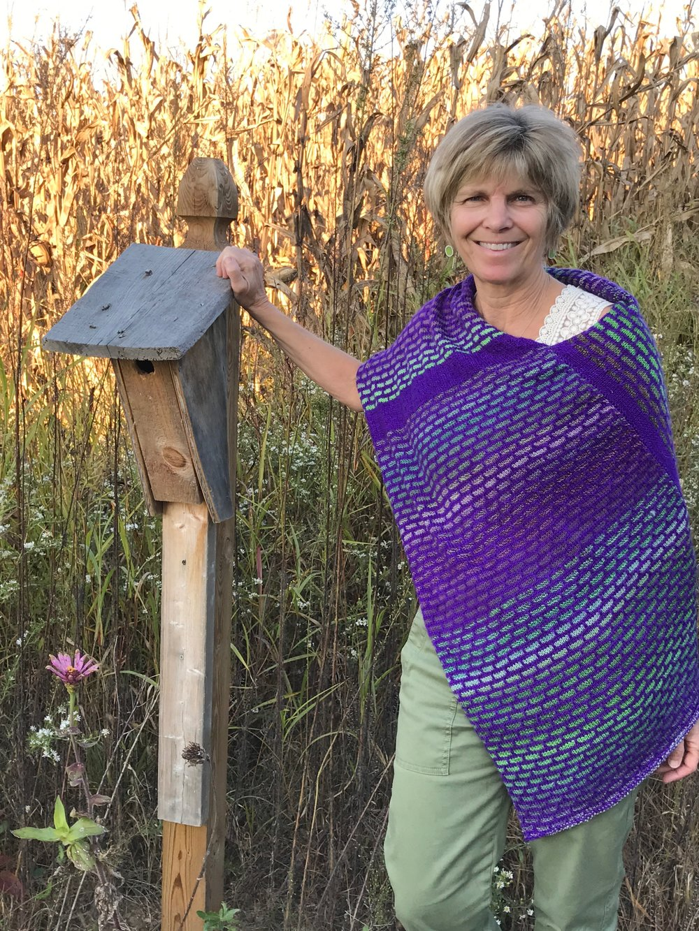 I've knit my way through many a television show, airplane trip and sporting event. Here's a poncho I recently created. I'm thinking of writing up the pattern to include with the sale of one of my yarn bowls. What's the verdict? Would you like to make one for yourself?