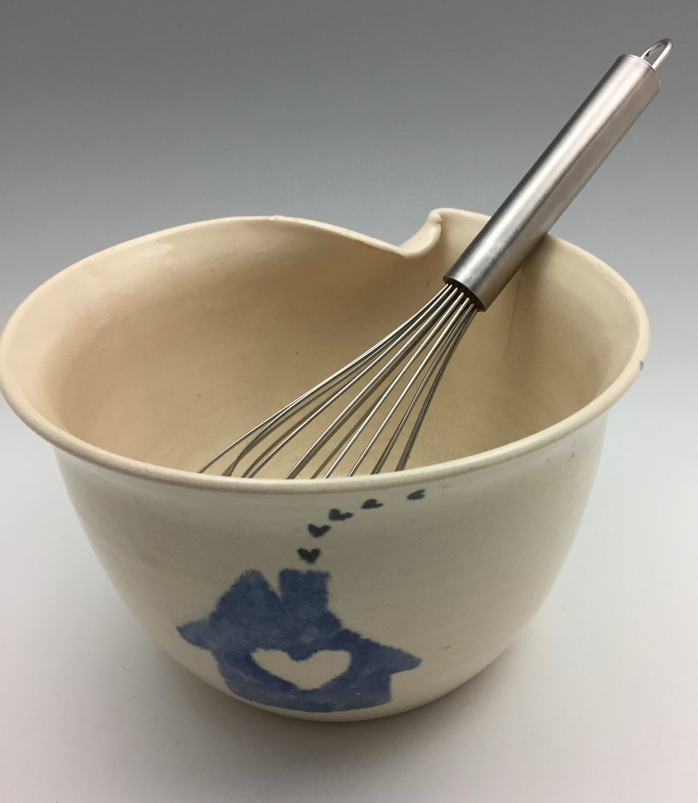 I made this mixing bowl using a potter's wheel in 1997. The thumb rest also acts as a pour spout for the bowl's contents. I always liked this shape; it's fantastically functional, so I'm working on recreating the form in a hand-built version. Click on the photo if you'd like me to make one for you!