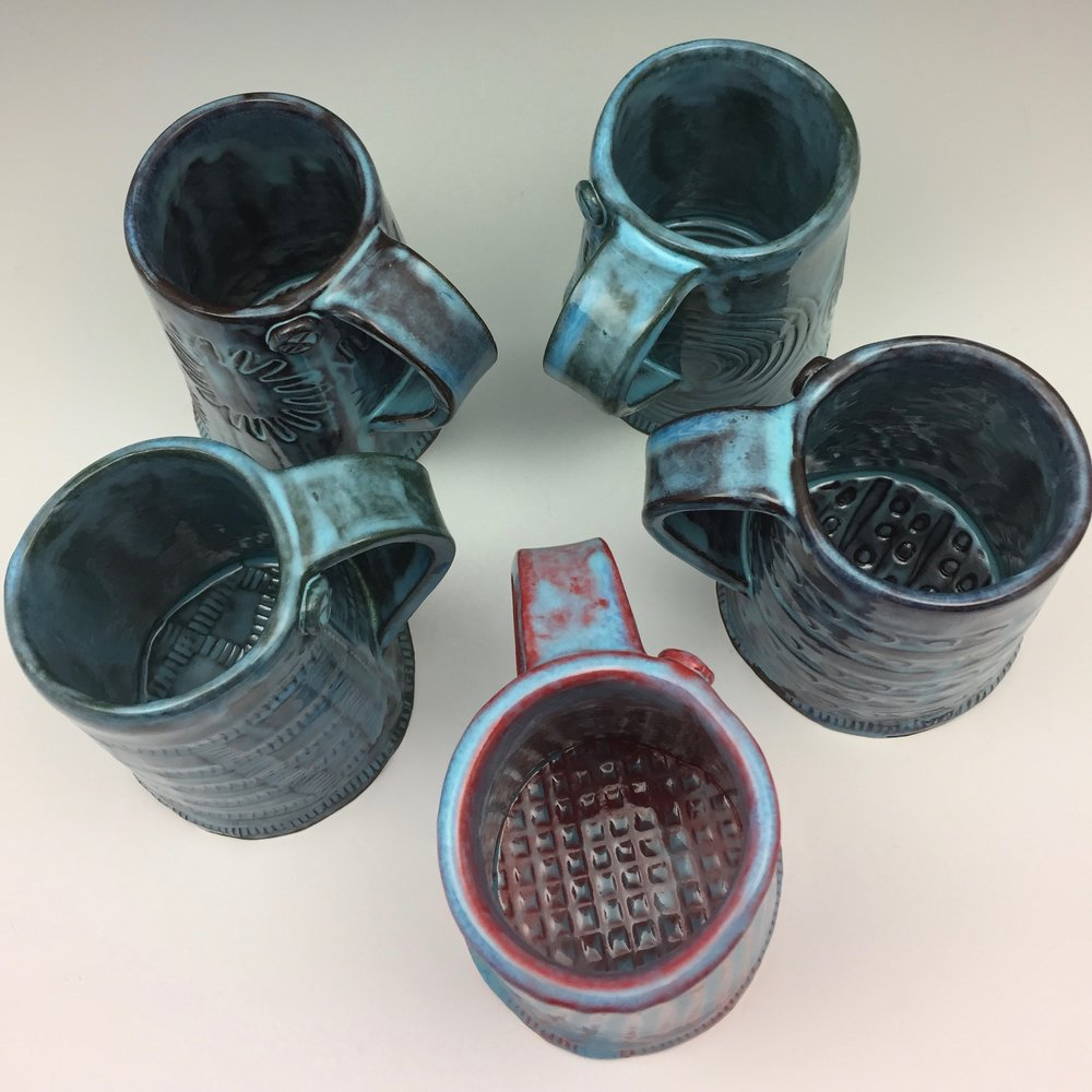 It's hard to believe the same blue glaze can look so different depending on the color that lies beneath! Here are some new mugs fresh from the kiln.