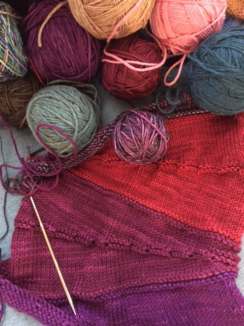 Here's the project on my knitting needles right now. I'm trying to use up some of my left-over yarn, so this interesting shawl project is perfect! The jumble of colors (monkey mind) will result in a useful expression of creativity (meditation)!