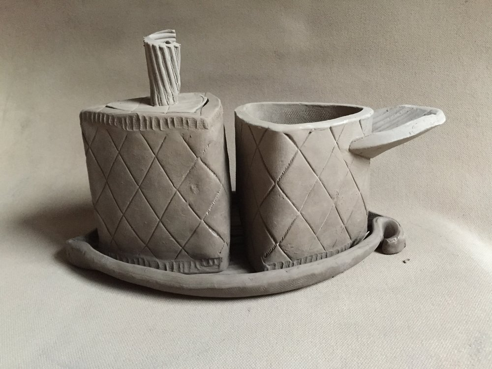 This sugar/creamer set I started this week is much smaller in scale to the three planters I made. The set consists of eight separate parts joined together. Just because it is smaller in size doesn't necessarily mean it should be priced less than a large piece.