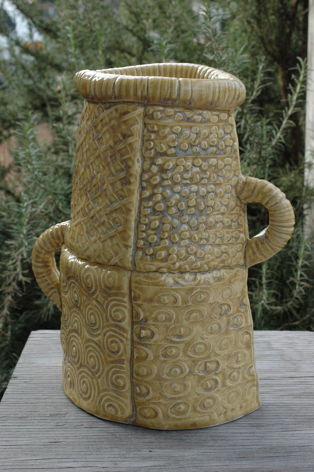 This vase shape was influenced by a vase Helene had in her house. I mimicked the design, use of different patterns and shape with a clay quilting method I learned in a handbuilding class.