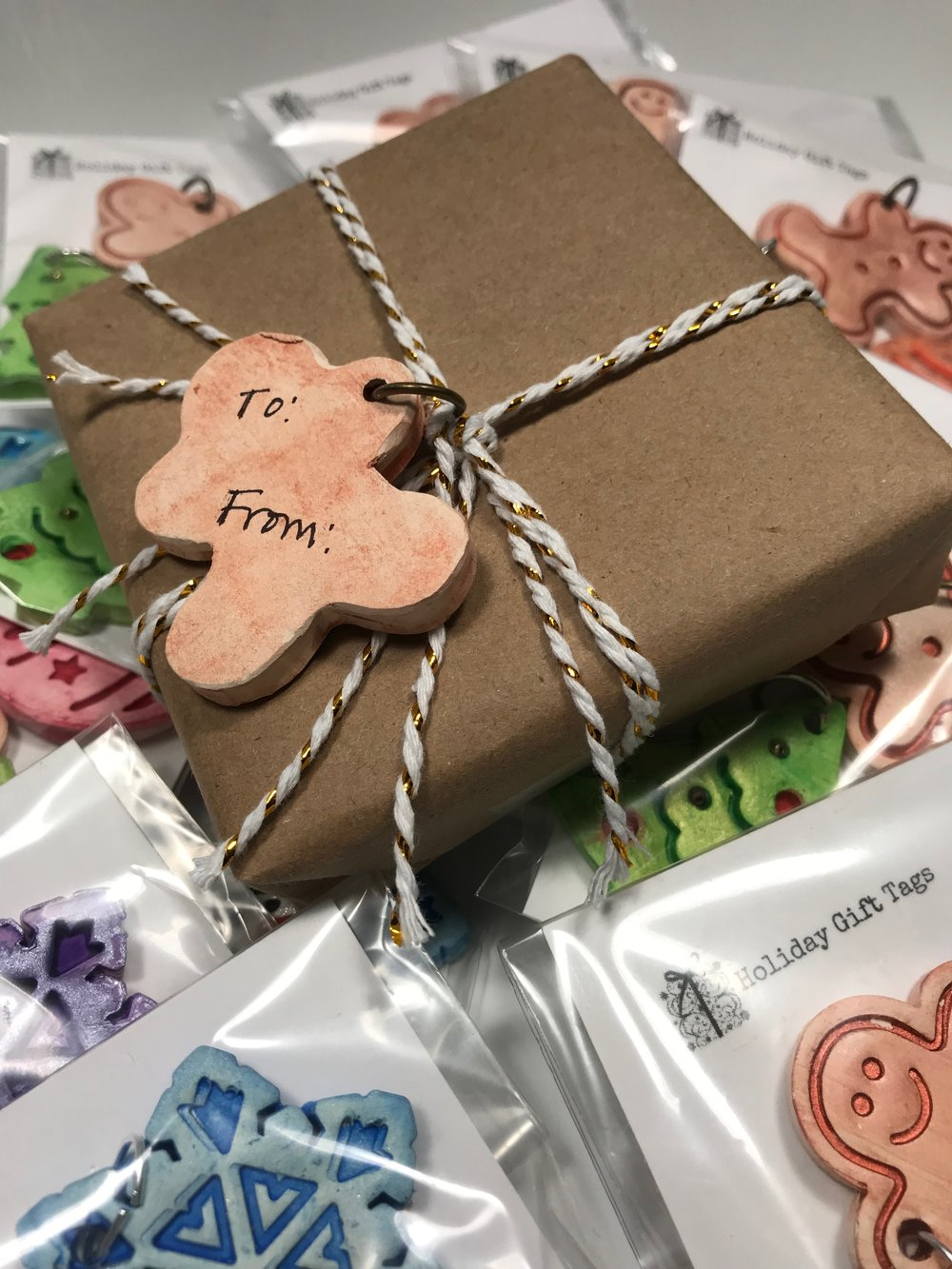 Want to add a little personalization to a package you're wrapping this holiday season? You can add your own special message to the back of each of these unique gift tags. A pack of five containing a gingerbread man, snowman, snowflake, tree, and ornament is $15. Click on the photo to order your set!