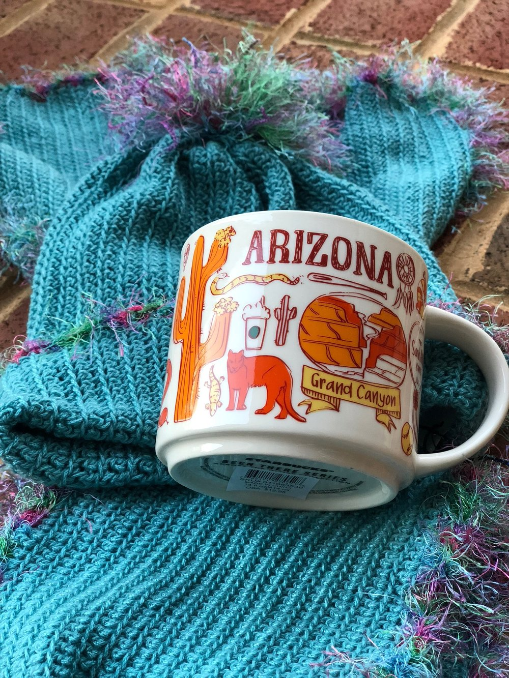 I received two surprise and considerate gifts this week. My former neighbors were in town visiting and stopped by. They now live in Arizona and brought me a mug from my favorite coffee shop! They know me well! The hat/scarf set was sent to me by a friend from Hilton Head. We have spent yarn time together stitching and talking. Her out-of-the-blue gift and note were so thoughtful!