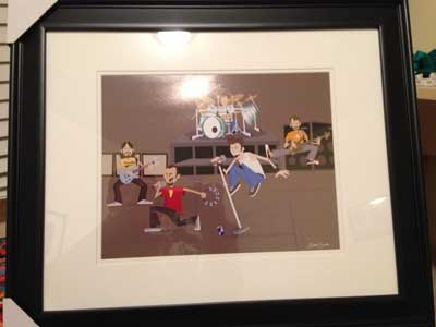 "The M.I.A. framed ""on stage"" print sent to 311 on 3/11 Day."