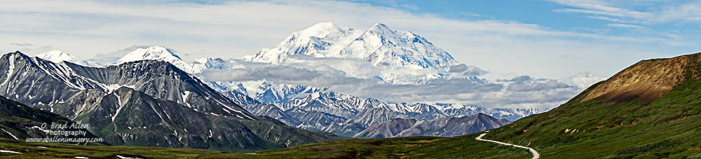 "Denali, ""The mountain"" as the guides and the local area semi residents call it. They say it is only visible 30% of the time. It is so large that it creates its own weather system,. The mountain can be summited but usually only during May and June. After these months it is avalanche season and becomes too dangerous."