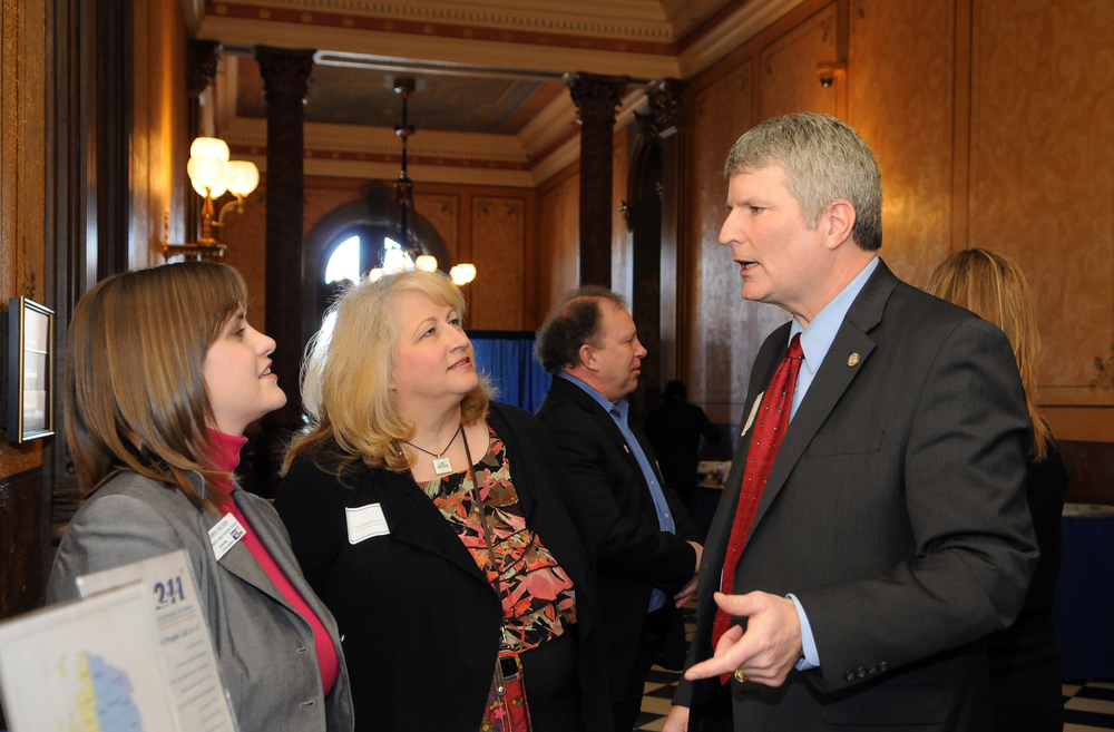 The United Way of the Lakeshore catch up with Senator Geoff Hansen at the 2014 MAUW and Michigan 2-1-1 Legislative Day.