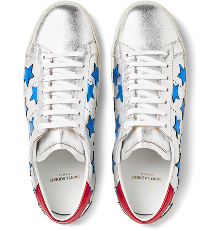 Leather appliqué stars elevate this low-top sneaker to statement maker. Perfectly patriotic when worn with red,white and blue but also perfect for all-year round when teamed with dark denim or to make an all white look pop.   As these sneakers are on a metallic silver base - I'd love to see how these translate for evening (with a less strict dress-code of course). I'm thinking dark denim, white dress shirt, and blazer. Leave out the tie to complement the Rock and roll attitude of the trainers.