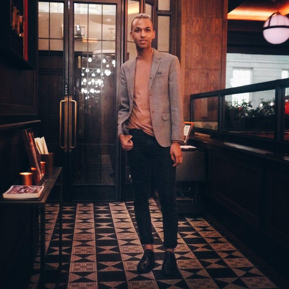 in a Zara rollneck and Club Monaco blazer
