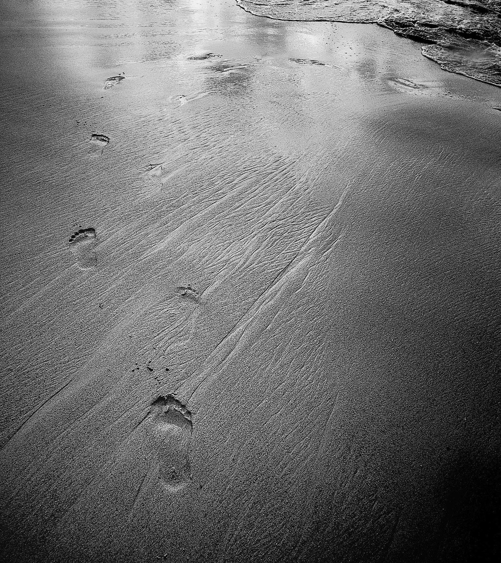 Footprints in the Sand - Carib by Eric Berger