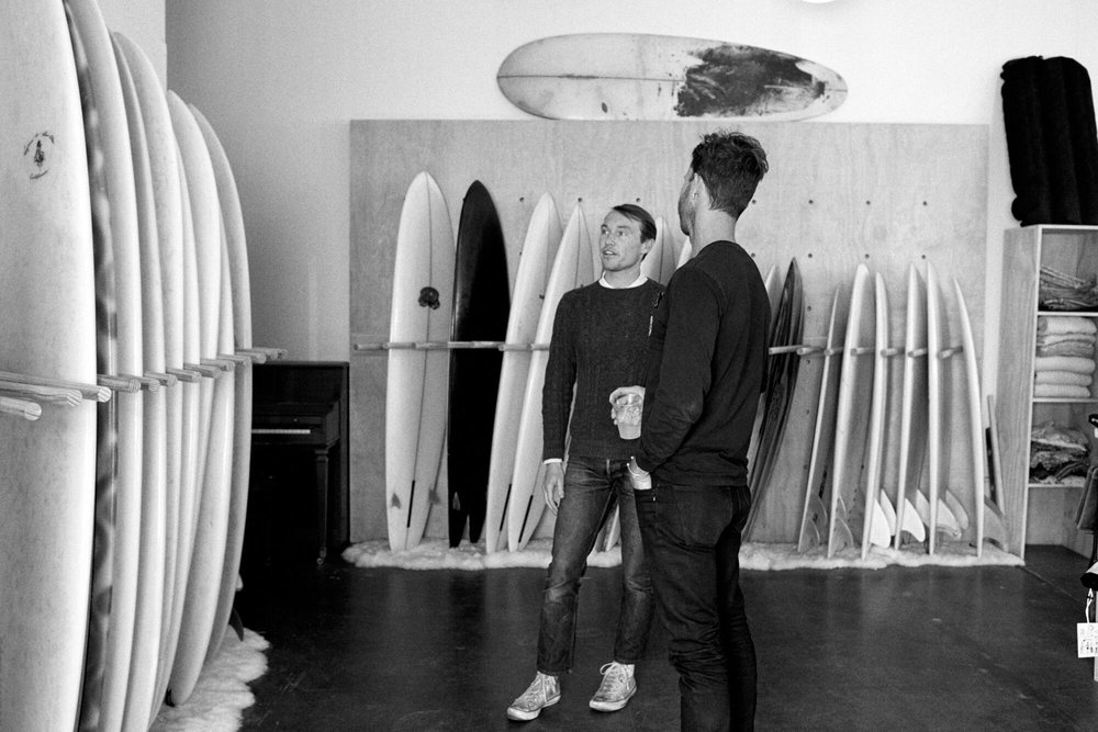 Sean discussing board design with Kyle Kennelly of Daydream Surf Shop. Photo by Lonnie Webb.
