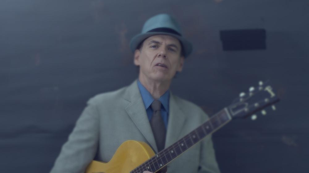 John Hiatt comes in guns-blazing on the opening track of Sunday Night Kill Myself.