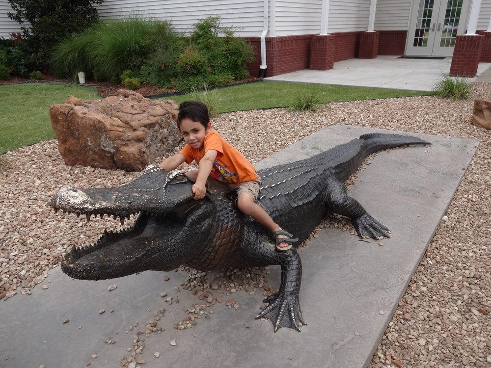 Tulsa Aquarium July 2013-Xavier wrestles an alligator!.JPG