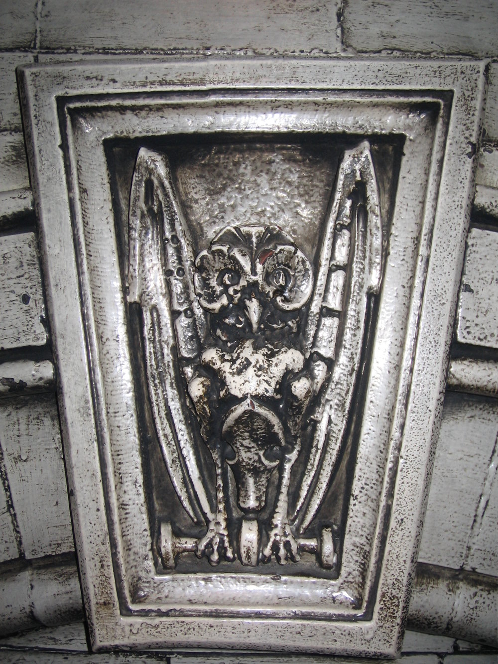 Creepy Carving on Fireplace at The Crescent