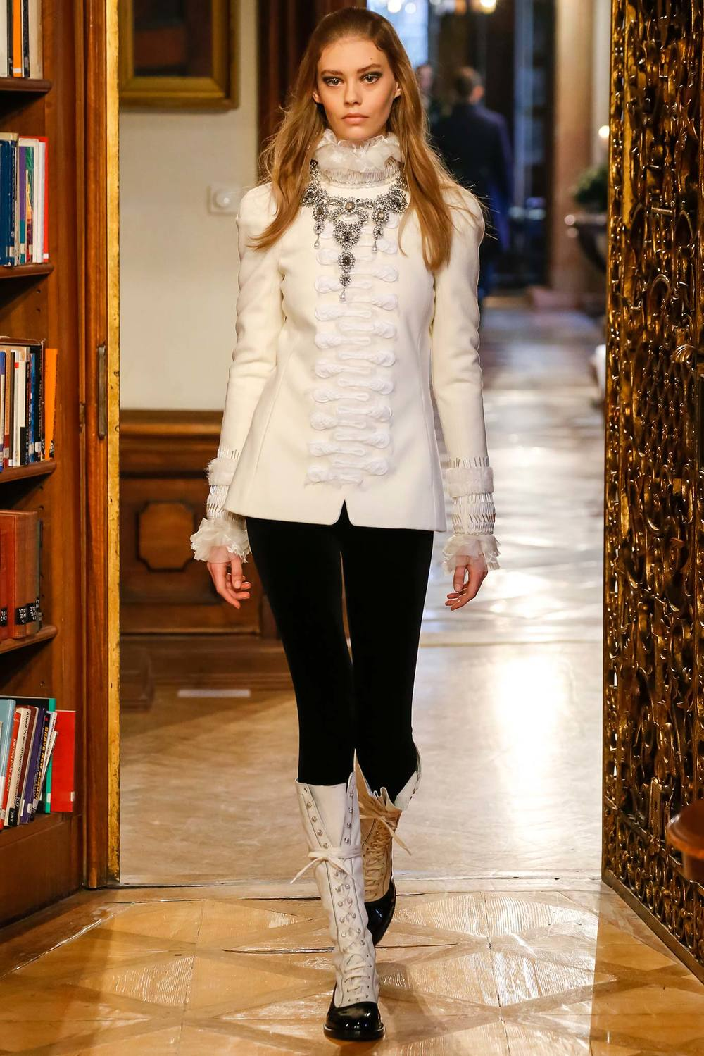 Love the laid back yet glam vibe. Leggings, statement boots and jacket - I can do that. Image courtesy of Style.com.