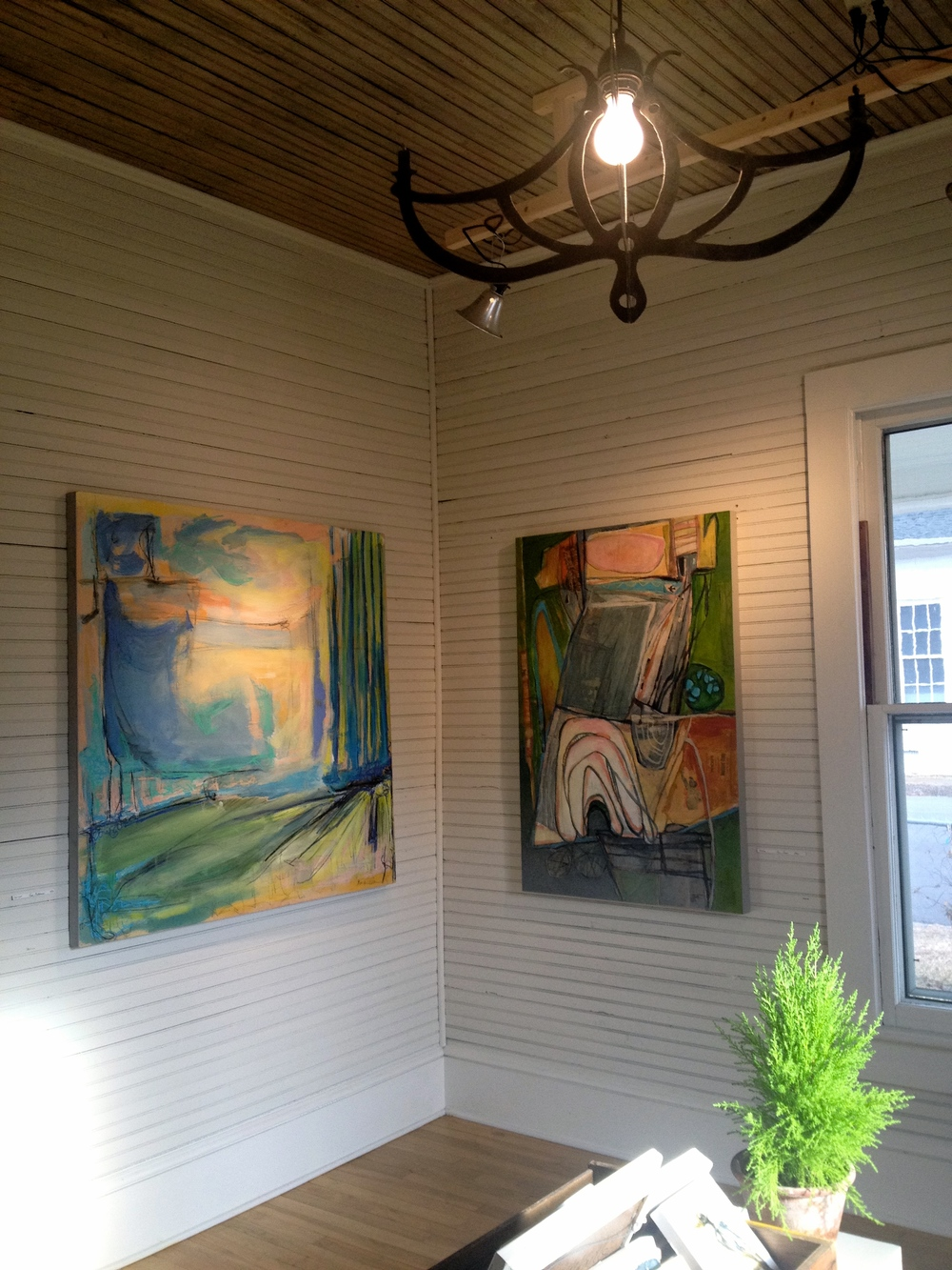finished- 4x4 mixed media(left)is now hanging in Art&Light Gallery next to my Studio mate, Kevin Isgett's piece (right).