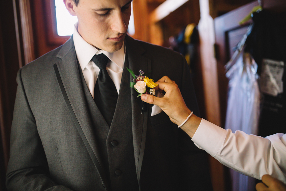 The Groom getting final touches to his suit King Francis Park Forest Wedding Ceremony Vancouver Island