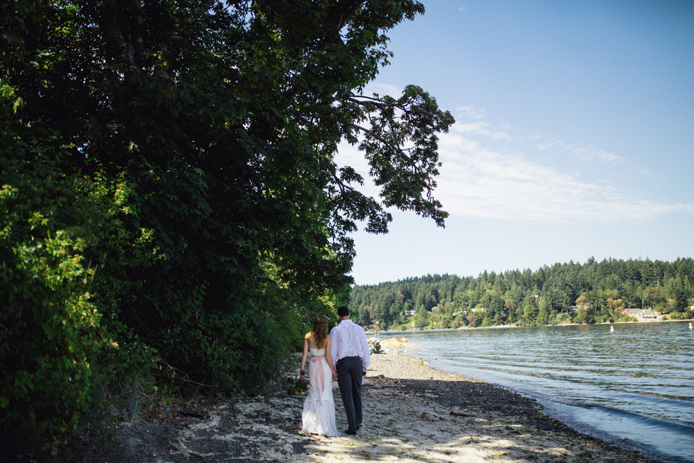 The Bride and the Groom walking alongside a river King Francis Park Forest Wedding Ceremony Vancouver Island