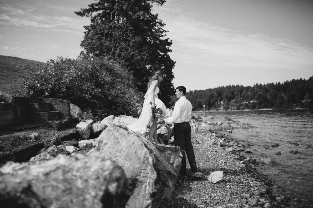 Photo of the newly wed Bride and Groom alongside the bay King Francis Park Forest Wedding the Guild Vancouver Island