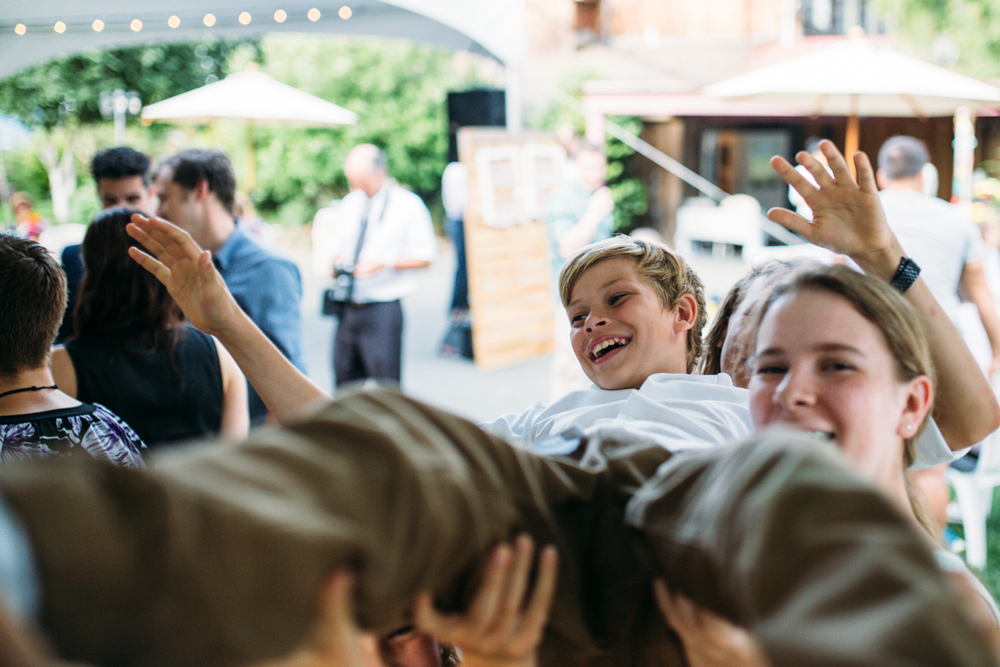People carries a boy at the wedding reception The Guild King Francis Park Forest Wedding Vancouver Island