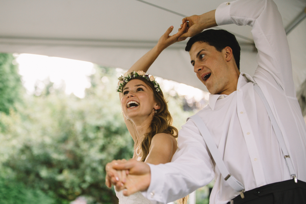 The newly wed couple Bride and Groom dancing merrily The Guild wedding reception King Francis Park Forest Wedding ceremony Vancouver Island