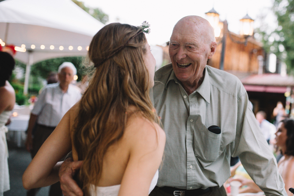 The Bride talking to an old man King Francis Park Forest Wedding Ceremony Vancouver Island The Guild Wedding reception