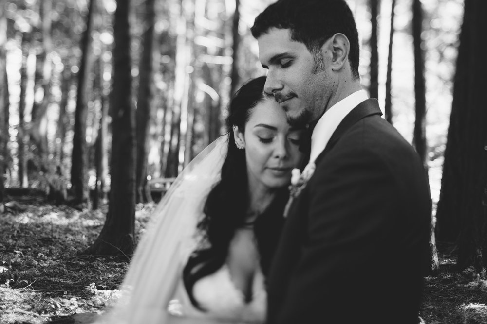 The Bride and Groom embracing each other Forest wedding Tofino Vancouver Island