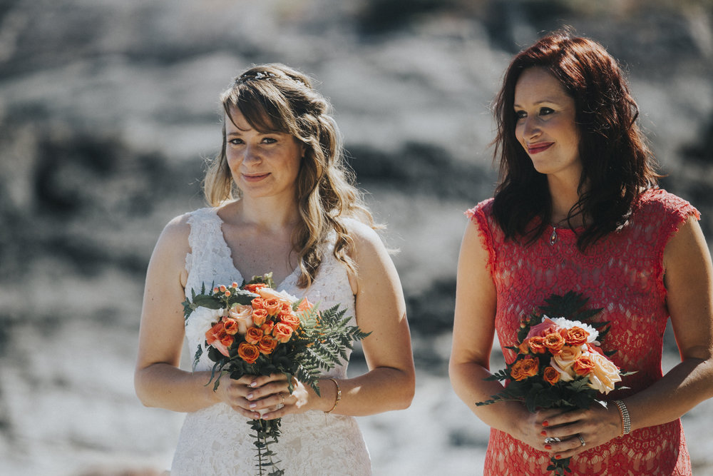 bride with sister at wedding ceremony seashell beach tofino