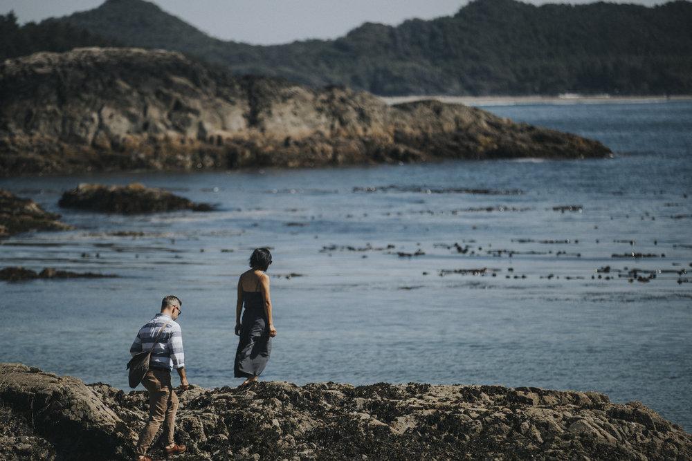 guests explore rocks at seashell beach wickaninnish wedding