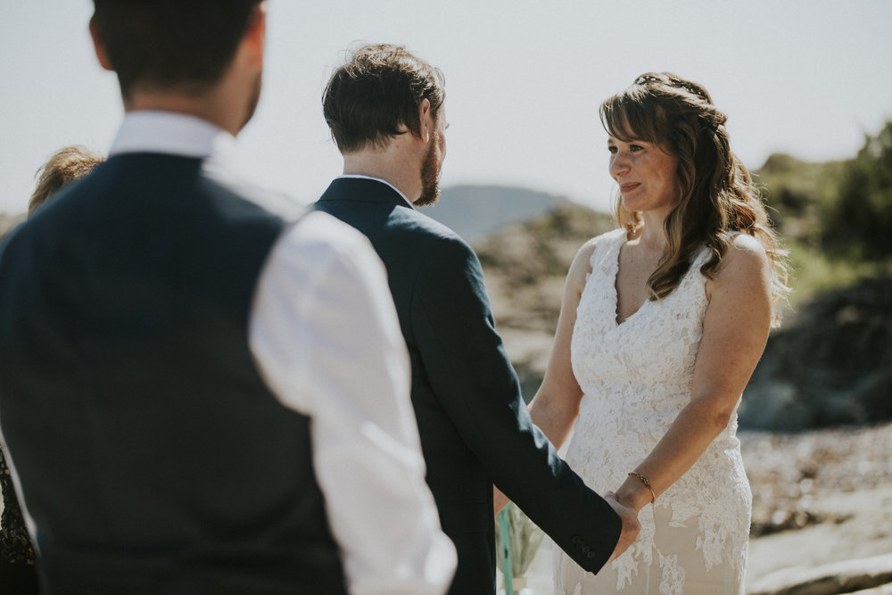 couple hold hands at wedding on beach tofino