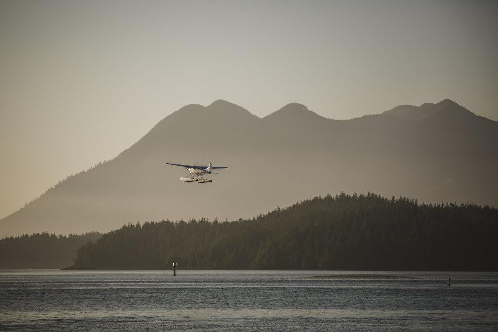 float plane in tofino sunset