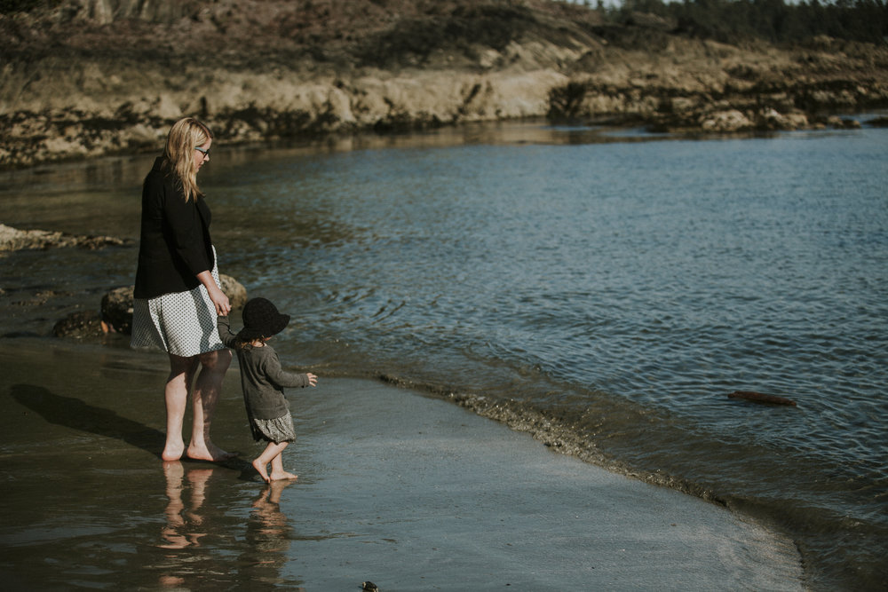 wedding guests explore beach in tofino ceremony