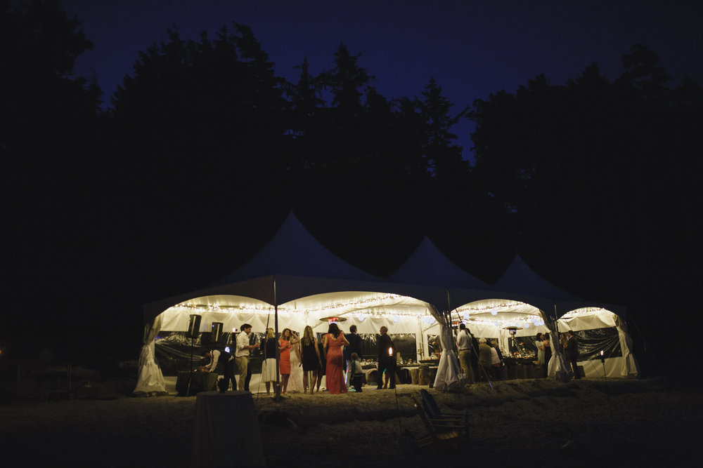tent on beach for reception at wickaninnish inn beach wedding tofino