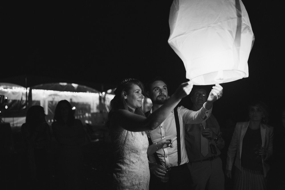 couple with paper lantern wickaninnish inn beach wedding tofino