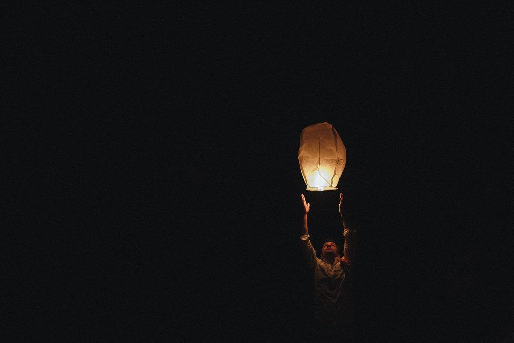 paper lanter and man on beach at wickaninnish inn wedding