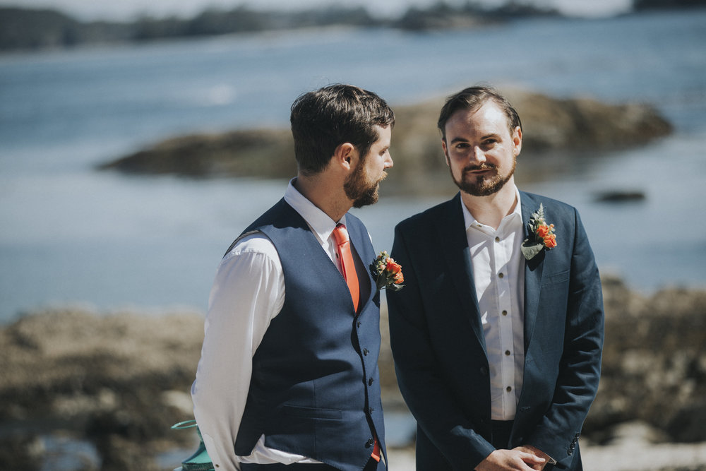 groom and groomsman waits for bride at beach wedding tofino