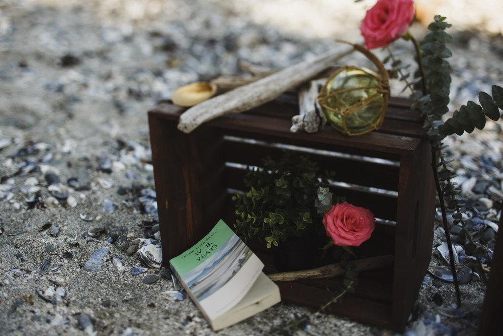 book and flowers at ceremony site seashell beach tofino