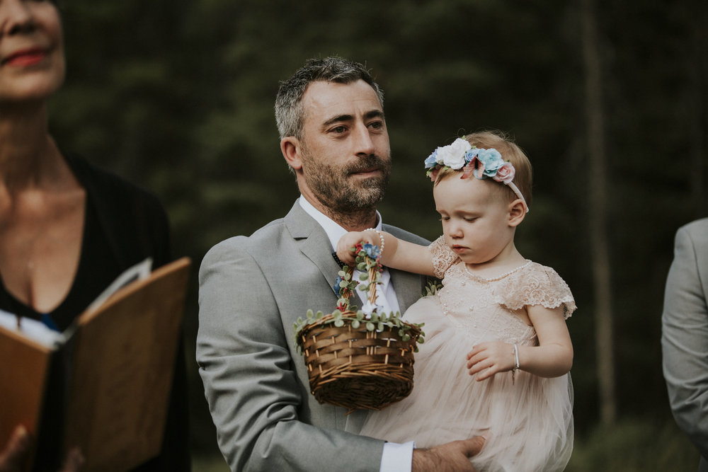 groom holds daughter at wedding ceremony mt norquay