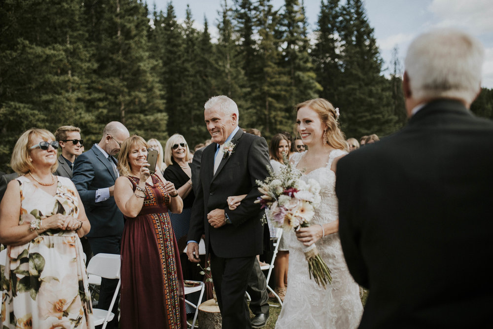 bride walks down isle with father mt norquay wedding
