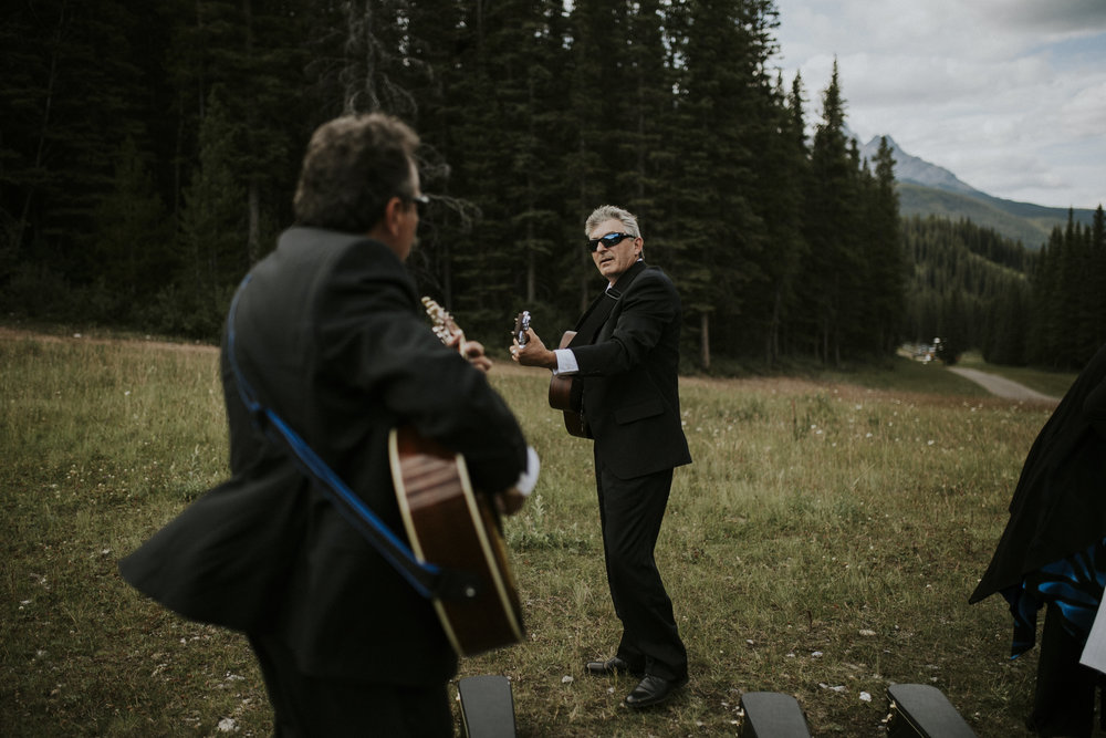 men play guitar at wedding ceremony mt norquay banff